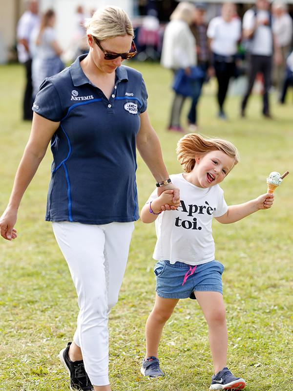 Zara Tindall takes a stroll with her daughter Mia, who enjoys a delicious ice cream.