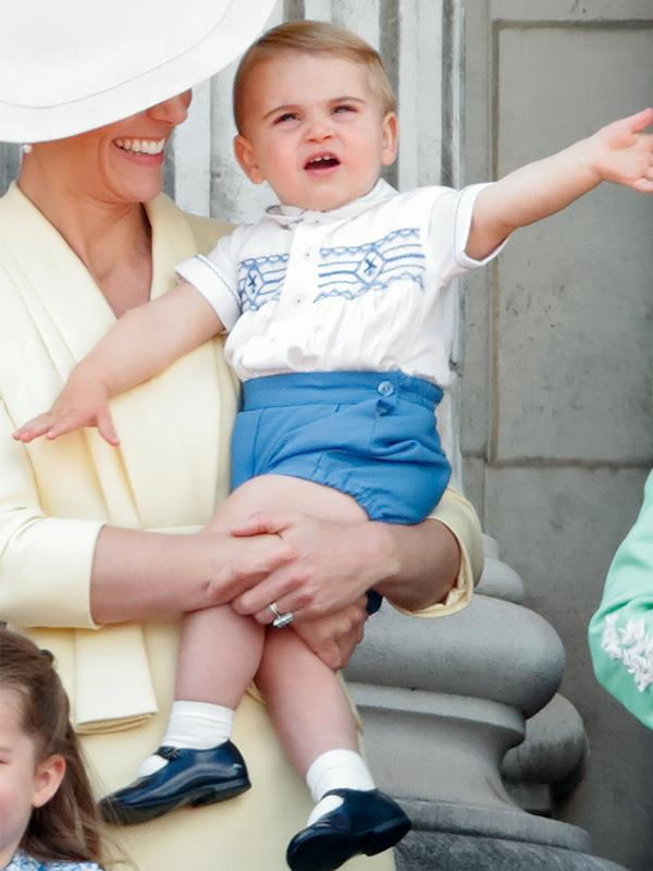 A very lively Prince Louis plays with his mother Duchess Catherine at Trooping the Colour earlier this year.