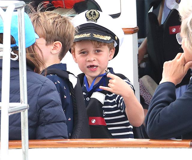 Prince George (and his two missing front teeth!) watched on as his parents Duchess Catherine and Prince William took part in a charity sailing race on the water.