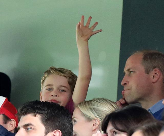 Prince George gets into the spirit at a sporting match with his father Prince William.