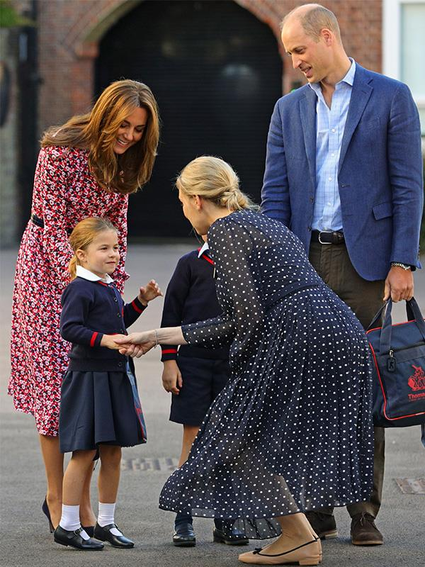 Princess Charlotte shakes her new teacher's hand on her first day of school in London.