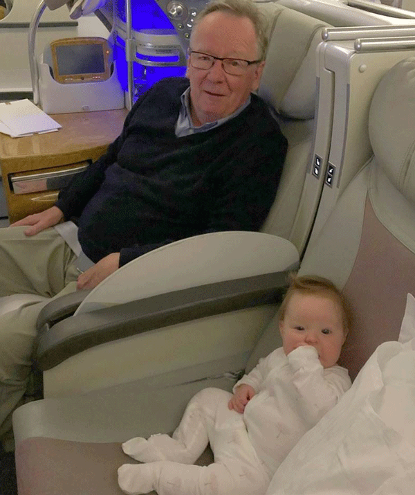 On grandad duty! Fifi's dad provides the inflight entertainment to his grandaughter, Daisy.