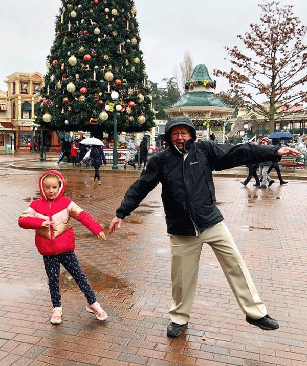 Trixie dancing with her grandad in the Disneyland main square.