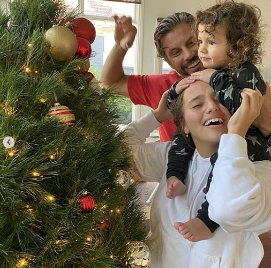 And she looks like she's having a blast decorating the tree with big sis Eve!