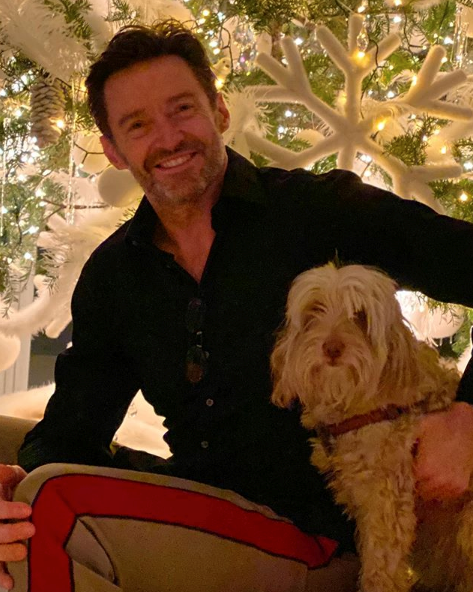 Christmas is a time to spend with the ones you love- and Hugh Jackman and his pup Allegra look very merry!