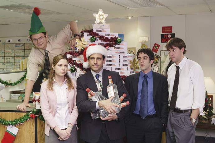 """**The Office (Stan)** <br><br> ***Season 2, Episode 10 – """"Christmas Party""""*** <br><br> Michael decides to turn the office's Secret Santa into a """"Yankee Swap"""" after he exceeds the $20 limit by buying Ryan a $400 video iPod. Chaos ensues. <br><br> This episode features classic Jim and Pam awkwardness, after he buys her a thoughtful gift and she ruthlessly swaps it for the iPod. <br><br> After the Yankee Swap ends in excruciating awkwardness, Michael tries to lighten the mood by buying alcohol for the Christmas party which quickly gets out of control. Even more chaos ensues and we can't help but love it."""