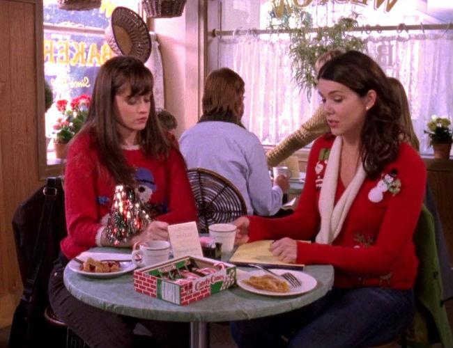 """**Gilmore Girls (Netflix)** <br><br> ***Season 7, Episode 11 - """"Santa's Secret Stuff""""*** <br><br> After missing the real Christmas to spend time with Logan in London, Rory returns home to find Lorelai has saved the magic of the holidays for her. From decorating the tree, to making their own candy cane coffee, the girls enjoy being festive in Stars Hollow. <br><br> But as they recreate the snowy season, it becomes even more clear that Chris and Lorelai's relationship is on the rocks."""