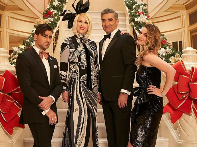 """**Schitt's Creek** <br><br> ***Season 4, Episode 13 – """"Merry Christmas, Johnny Rose*** <br><br> This holiday special featured a hilarious throwback to when the Schitt family were still flushed with cash.  <br><br> As he was brought back down to reality from his fond memories of their extravagant Christmases, Johnny tried to gather the family and lift their holiday spirits with his own party at the motel."""