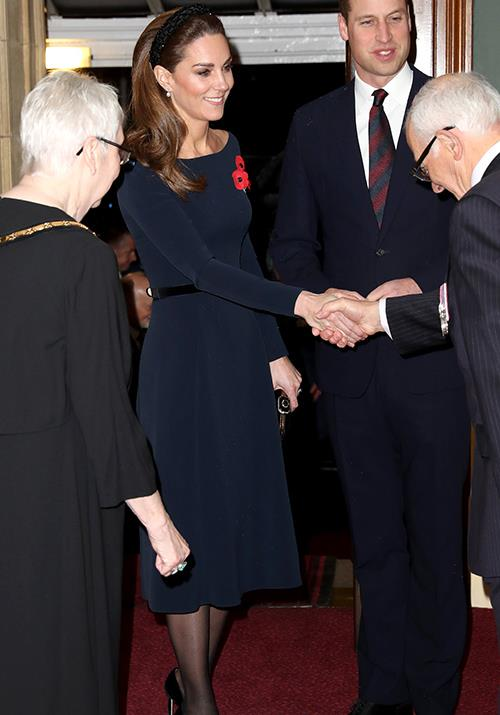 "In November, the Duchess attended the Festival of Remembrance in a gorgeous fitted navy dress by UFO. But it was what the royal chose to wear on her head that really got us ogling - she opted for a [sparkly headband](https://www.nowtolove.com.au/fashion/fashion-news/kate-middleton-zara-headband-60237|target=""_blank"") from the *very* affordable high street brand, Zara!"