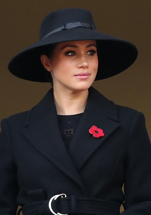 "The following day, Markle wore yet another [stunning black ensemble](https://www.nowtolove.com.au/royals/british-royal-family/royals-remembrance-day-60230|target=""_blank""), opting for a dark coat and wide-brimmed hat. Her smokey eye-makeup also looked gorgeous."
