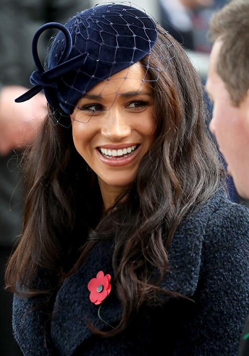 Meghan's fresh make-up look for the day was also on point - and how perfect is her Philip Treacy facinator?