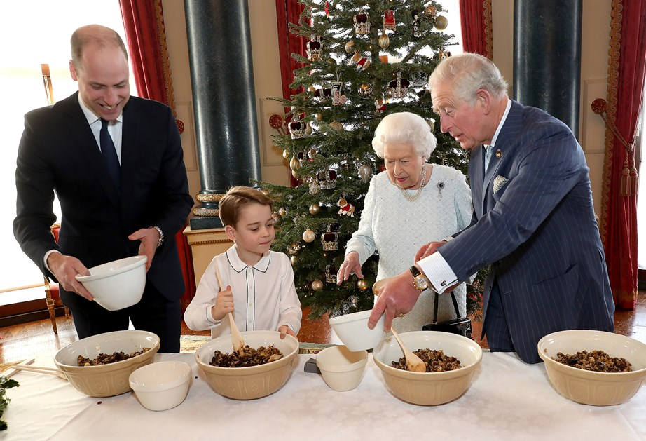 The Queen and her three heirs are helping to spread that Christmas cheer. *(Image: Getty)*