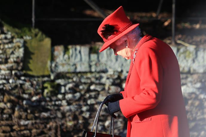 The Queen looked particularly festive in bright red.