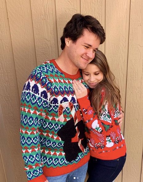 Engaged lovebirds Bindi Irwin and Chandler Powell were feeling the love on Christmas Day - with some very festive jumpers to boot.