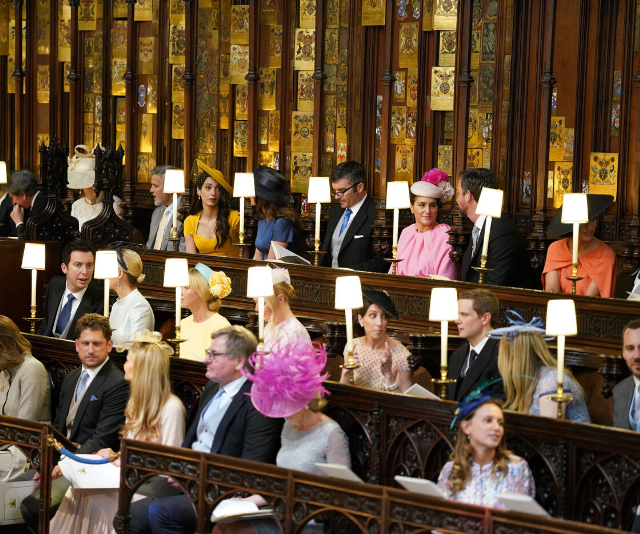 You can see Janina to the right of this photo, in the orange dress and black hat, sitting among Harry and Meghan's closest friends.
