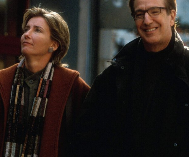 Emma Thompson and Alan Rickman's characters in *Love Actually*, during happier times.
