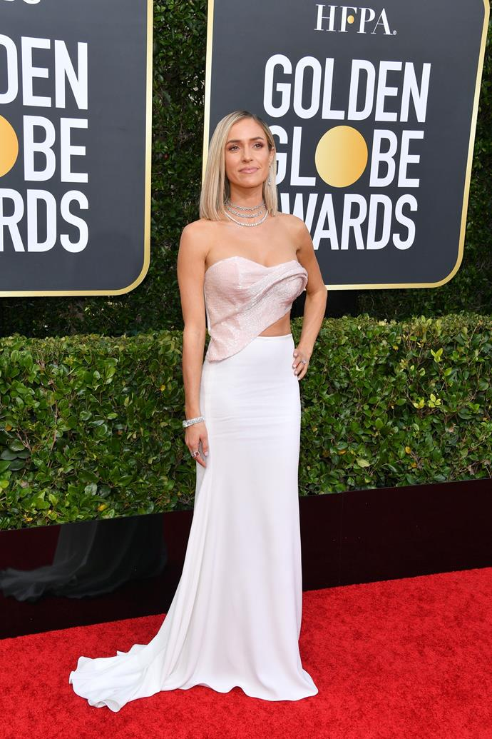 *E!* host and former *Hills* starlet Kristin Cavallari opts for a chic pastel pink and white gown.