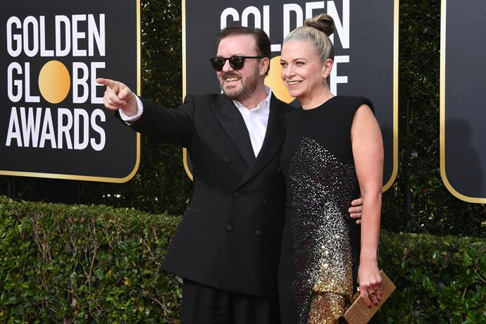 The host has arrived! Ricky Gervais and wife Jane Fallon are all smiles.