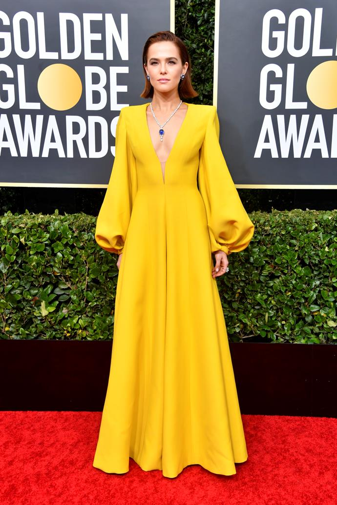 Actress Zoey Deutch stands out in buttercup yellow as she tackles the red carpet.