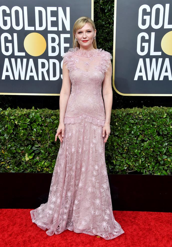 Kirsten Dunst is pretty in pink for her grand entrance.