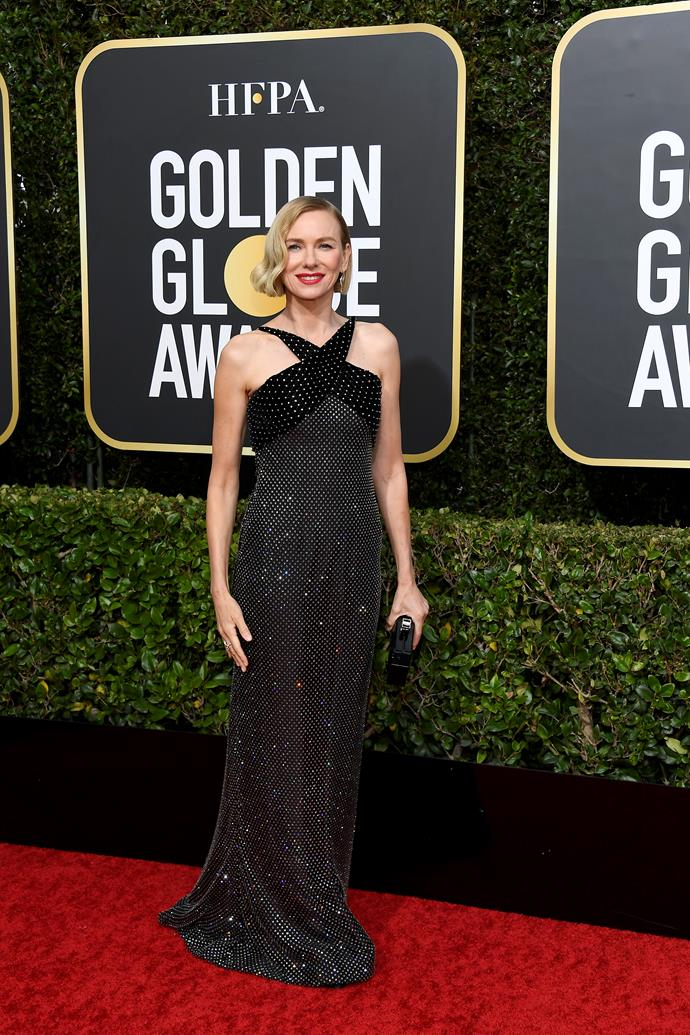 Aussie actress Naomi Watts is utterly divine in this black floor-length creation.