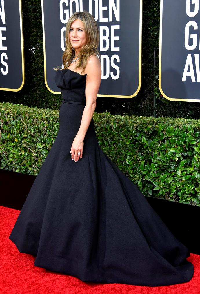 Jennifer Aniston wears a knockout black strapless ensemble - and single-handedly propels herself into the best dressed category.