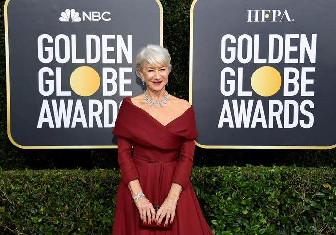 Helen Mirren is absolutely glowing in this deep red off-shoulder gown.