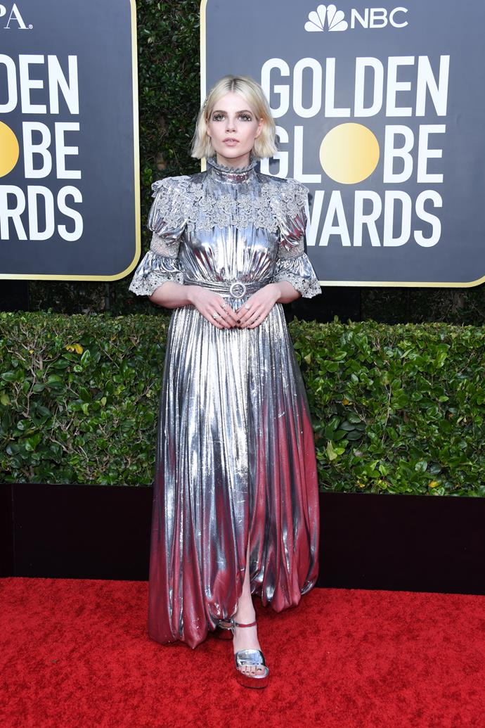British actress Lucy Boynton shines in a unique silver ensemble. Check out those sleeves!
