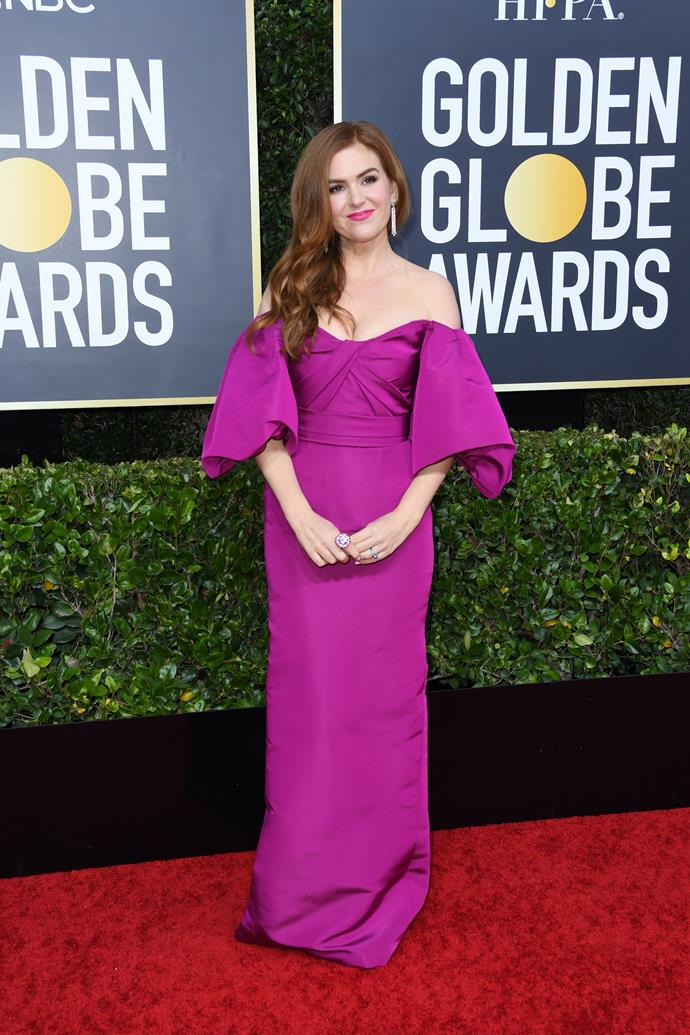 Australian acrtress Isla Fisher opts for a bright purple off-shoulder design.