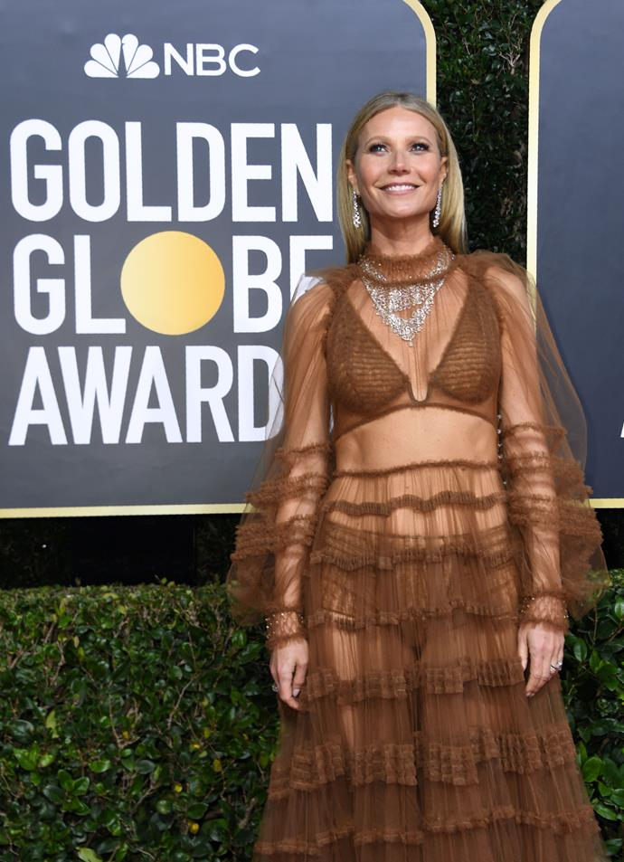Gwyneth Paltrow makes a sheer statement in this mahogany gown - we can't help but admire her bravery in pulling this off!