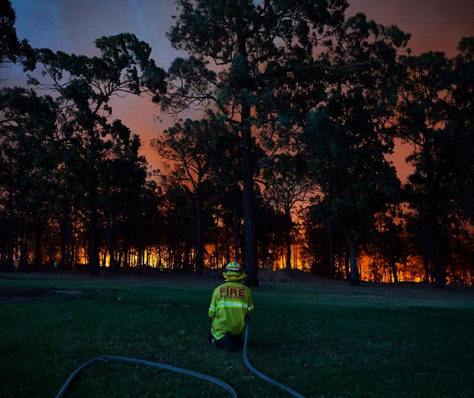 Here, fire crews wait at a property along Putty Road, north of Sydney, as the fire front approaches on November 15, 2019.