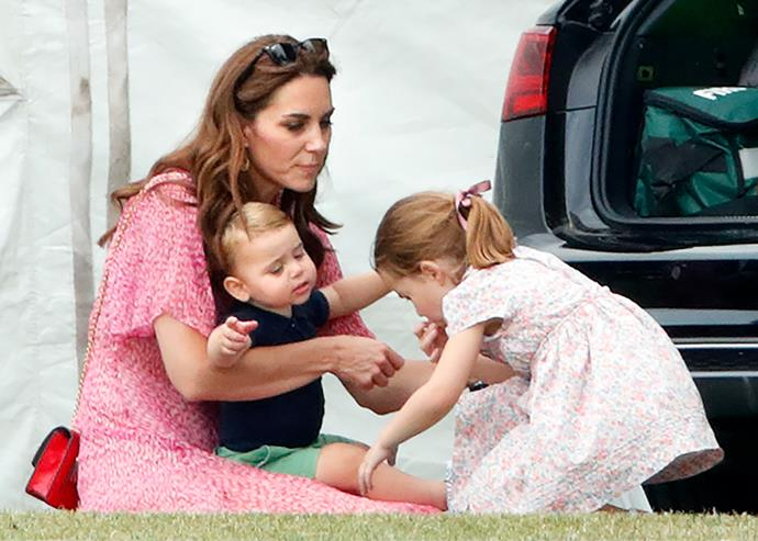 **Cuddles with mum:** Our hearts burst when we saw the royal mum-of-three playing with her kids at the polo.