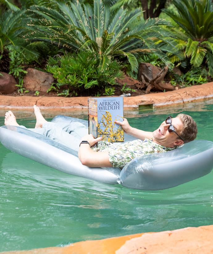 Dr Chris Brown relaxing when not hosting, though is on call for the local vets in South Africa.