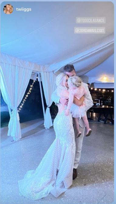 Daughter Charlie Rose joined her parents for the first dance.