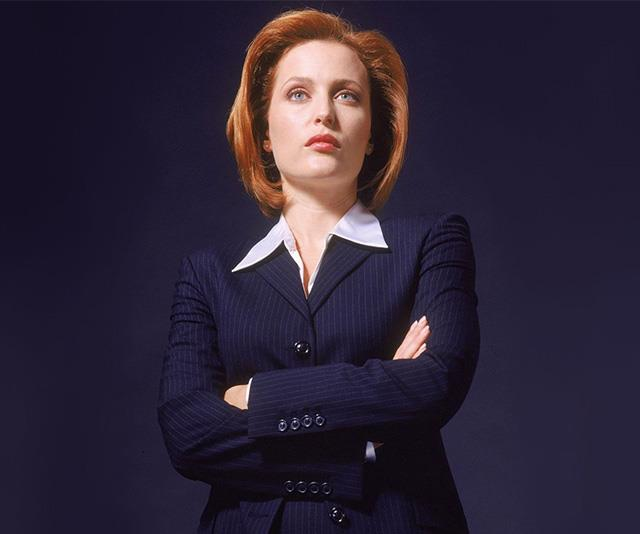 In one of the earliest promo shoots for *The X-Files*, showcasing Scully's bright red bob.