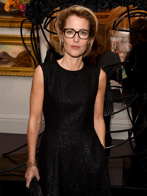 So chic! Wearing a classic LBD in 2018, with her signature dark reading glasses.