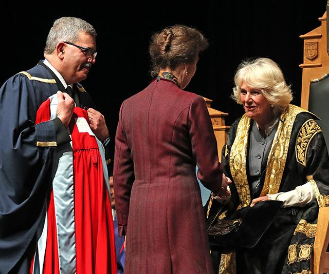 Camilla shook Anne's hand as she presented her with the award.