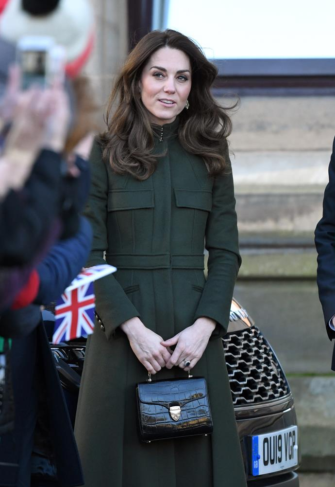 Kate looked stunning in a green Alexander McQueen coat.