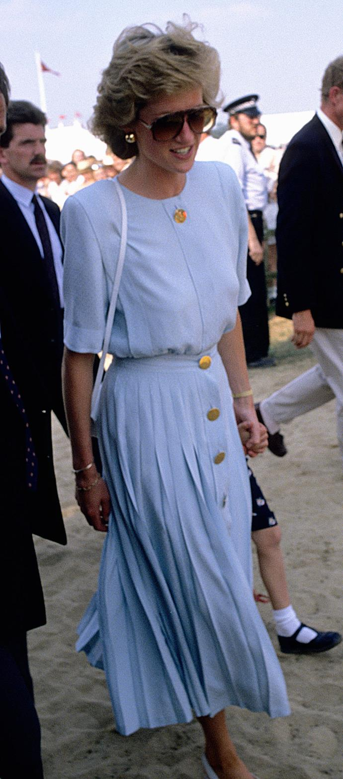 Back at the polo in 1985, Diana's baby blue floaty design was perfect for a day in the sun.