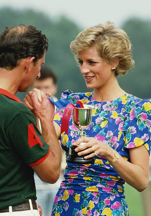 That same year, the Princess rocked some major colour in this bright floral dress - love the simple gold jewellery, too.