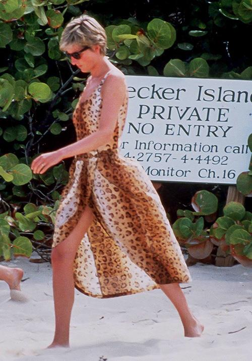 During a 1990 Caribbean holiday, the Princess rocked full leopard print in this beach swim dress of dreams.