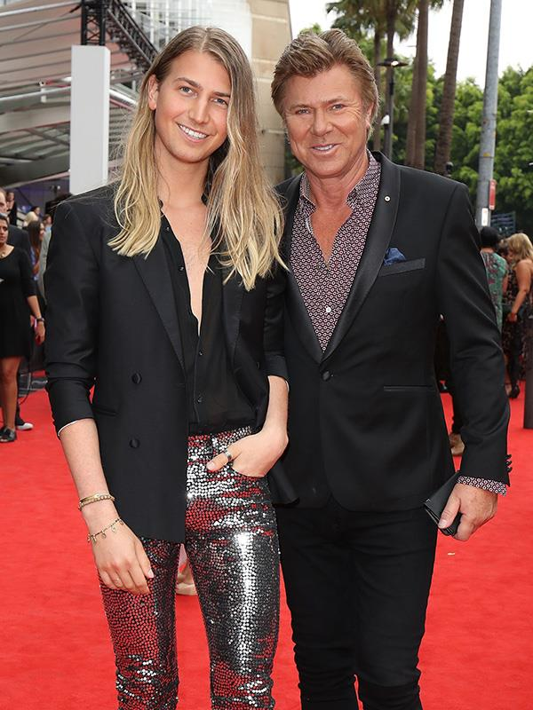 Christian and Richard walking the red carpet together.