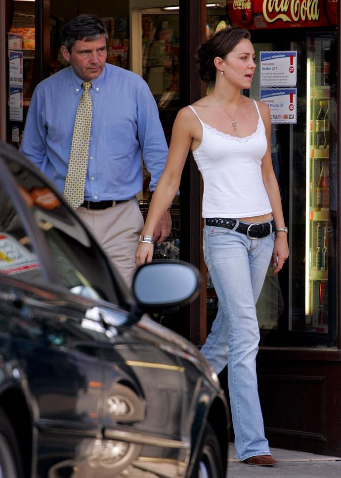 Ahead of her university graduation, Kate was snapped with dad Michael Middleton. A tank top and flared jeans couldn't be more definitive of the decade.