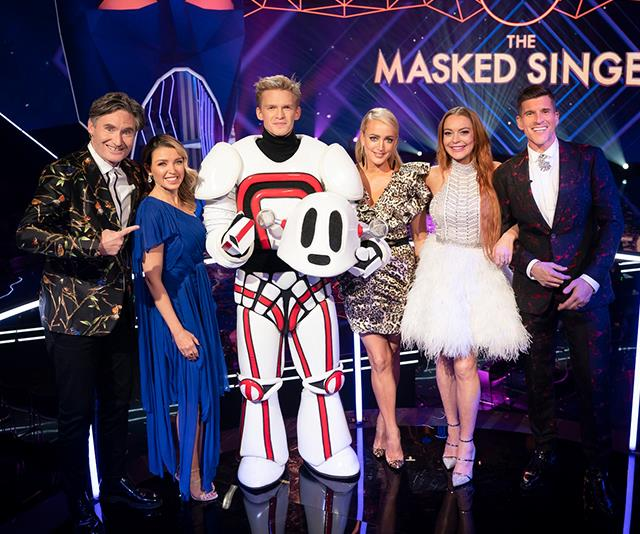 Hughesy with fellow *Masked Singer* judges, host Osher and winner of the competition, Cody Simpson. *Supplied*