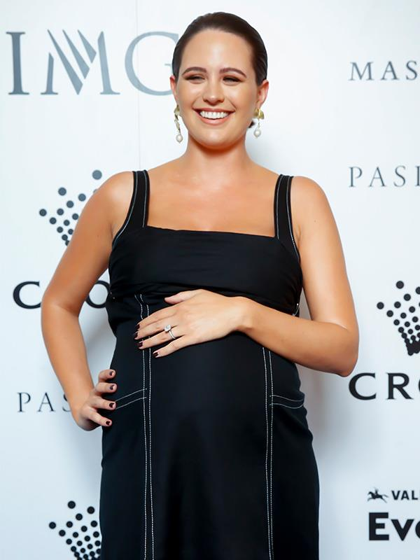 Jesinta's chic black dress is by Camilla and Marc.