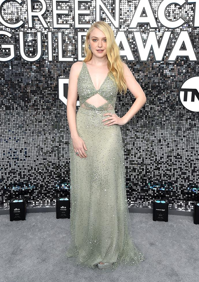 Dakota Fanning channels ethereal chic in this beautiful green gown.