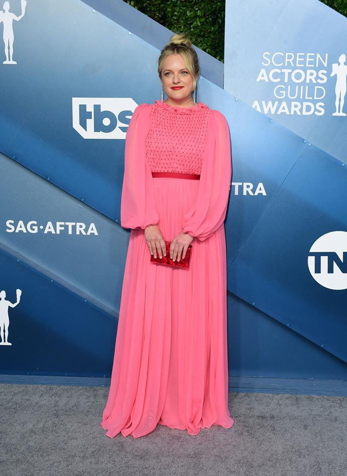 Elizabeth Moss makes a bright statement - in a very pink way...
