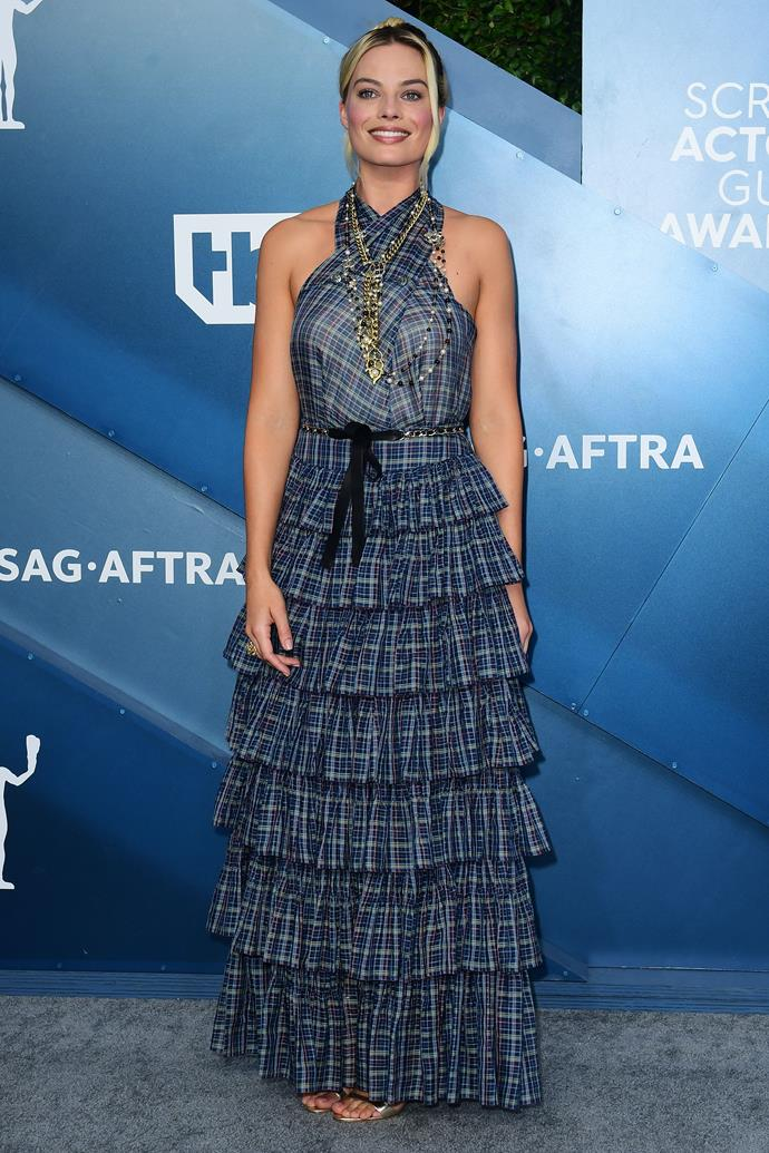 Margot Robbie goes for a tartan extravaganza - and check out the Chanel bling!