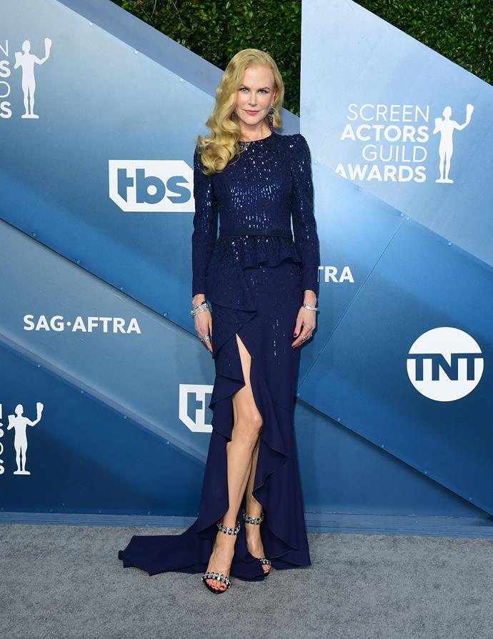 Nicole is elegant as ever in a sparkly blue design - ever the master of the humble leg pop.