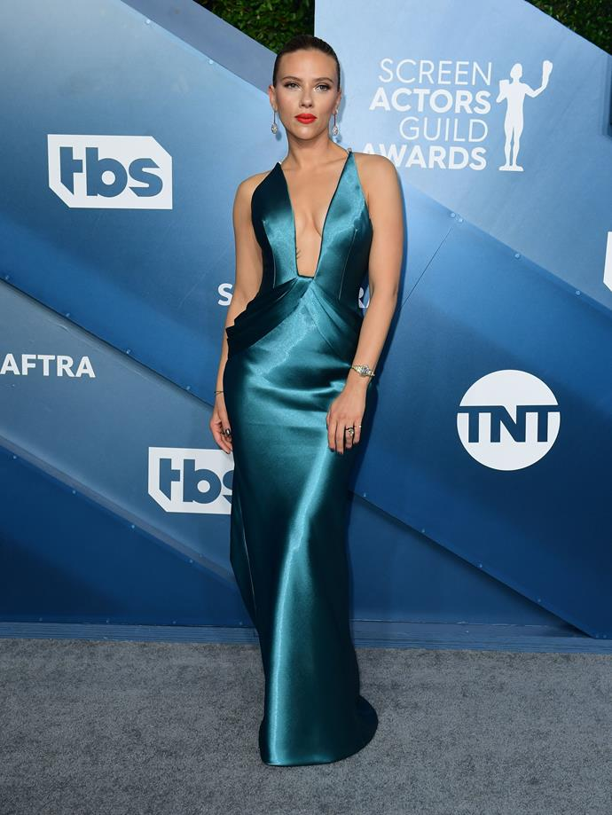 Ever the siren, Scarlett Johanssen looks incredible in this blue satin design - hands down one the the evening's best dressed!